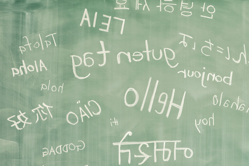 Hello, written on a chalkboard in multiple languages