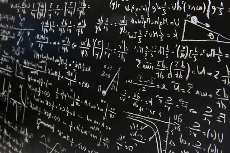 Mathematical equations on a chalkboard