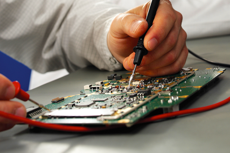 Man soldering a computer circuit