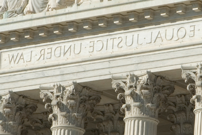 Columns of a courthouse saying Equal Justice Under Law