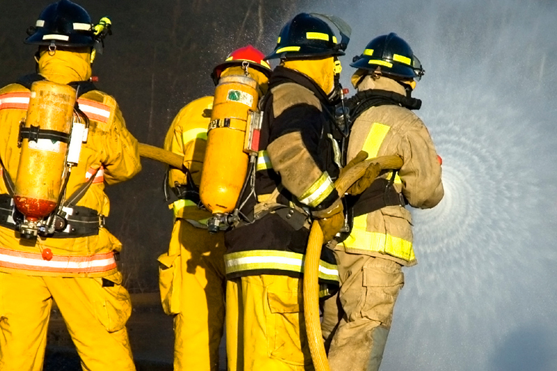 Firemen shooting water from a hose